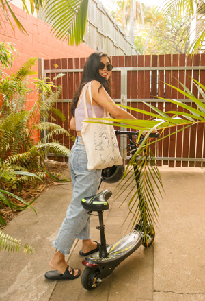 Girl riding a scooter at Civic Guesthouse